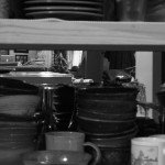 Hiding amongst the dishes.